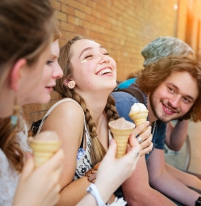 Group of urban teenage friends hanging out eating ice-cream.